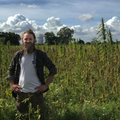 Cooperative member Dima in one of the Cooperatives organic hemp fields in Oxfordshire